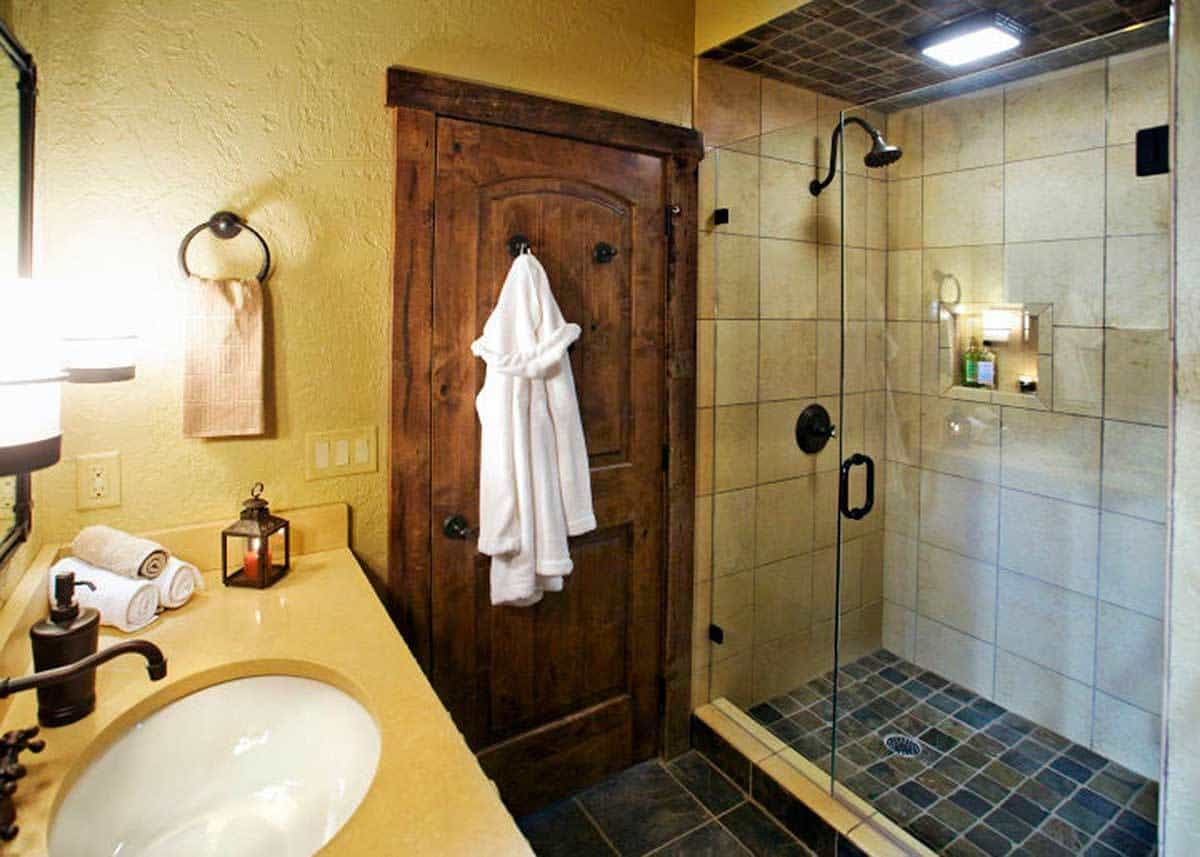 Bathroom with a glass-enclosed shower area.