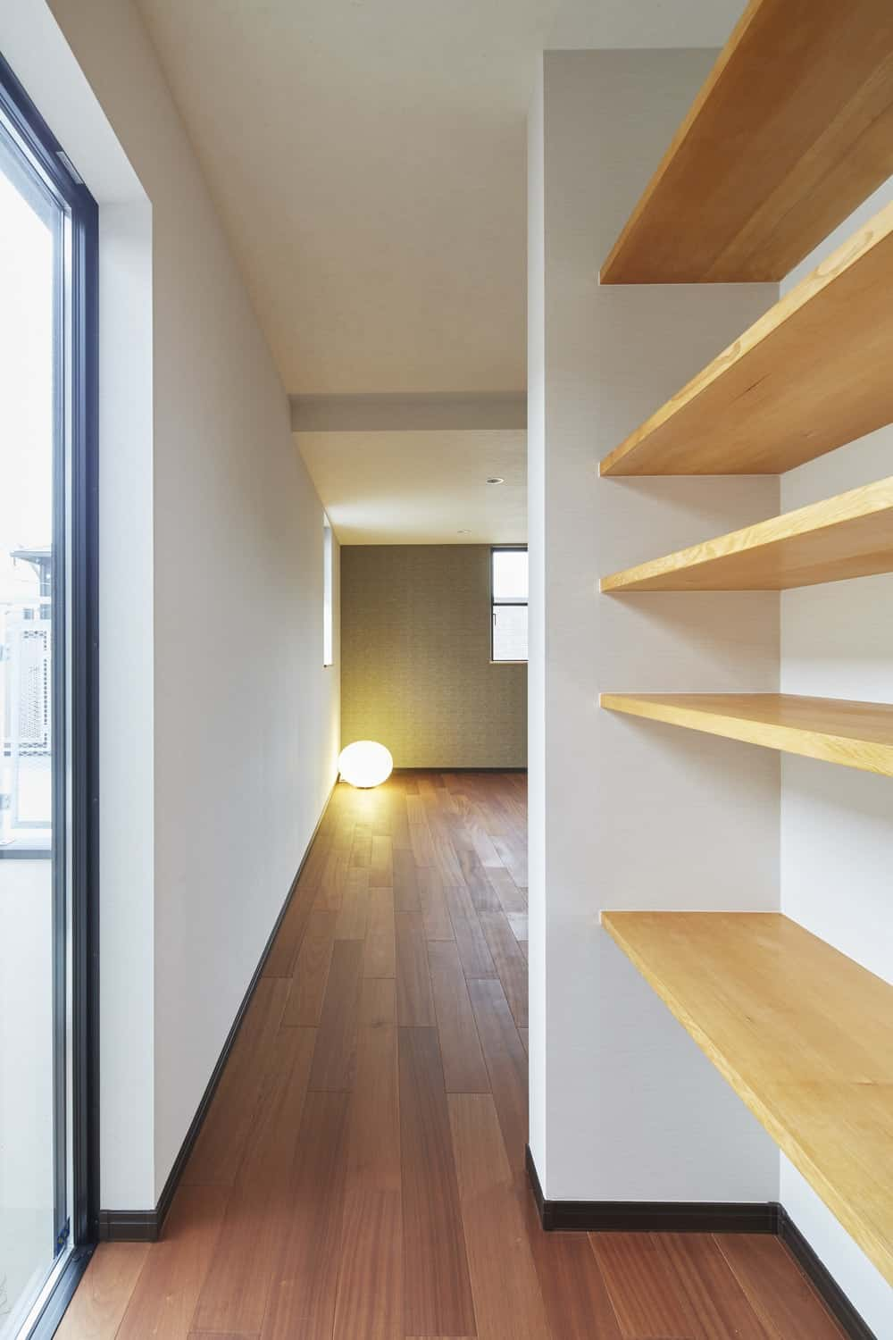 Wooden shelving in the Triple Stilt House designed by Archidance.