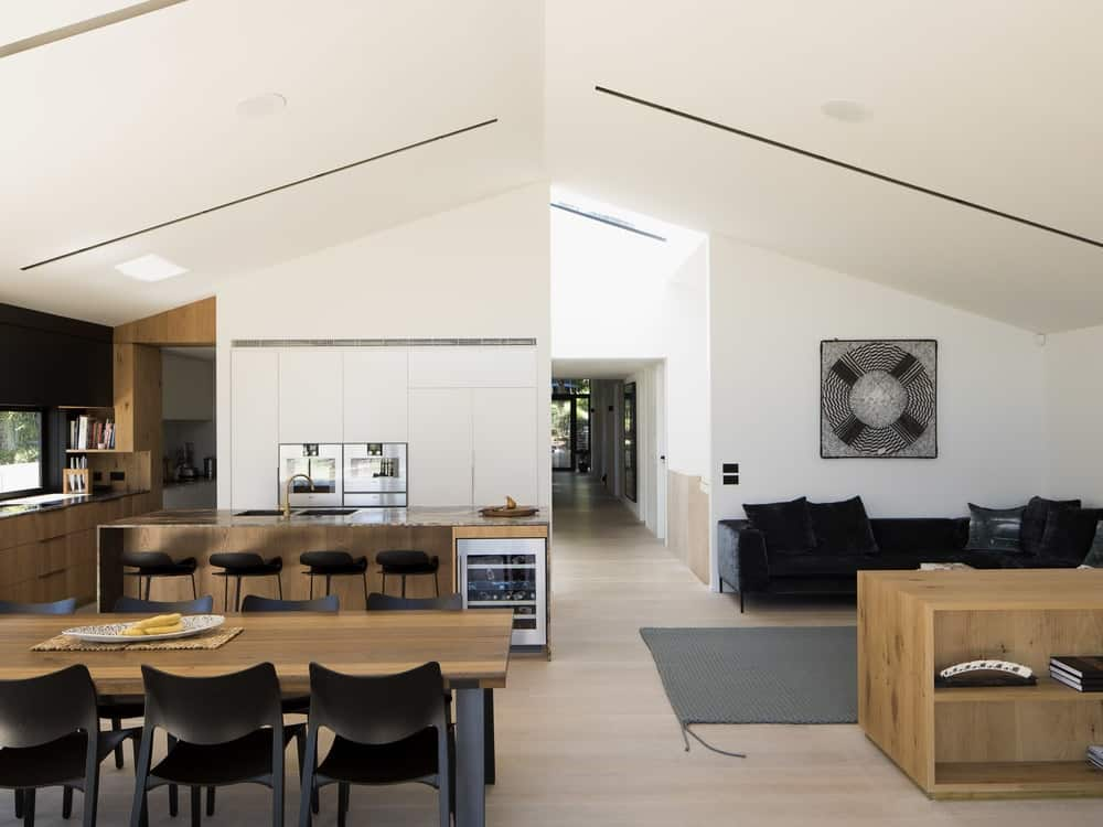 Open floor plan consisting of kitchen, dining and living spaces in the Herne Bay Hideaway designed by Lloyd Hartley Architects.