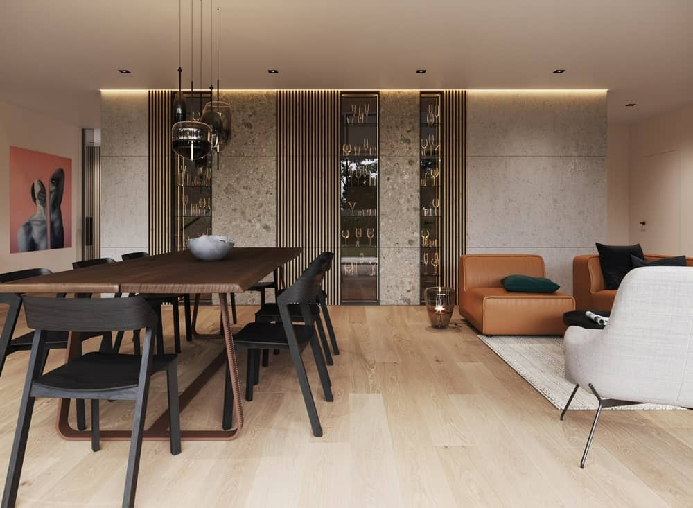 Shared dining area and living room in the Minimalist Home Interior designed by Johny Mrazko and Studioe.