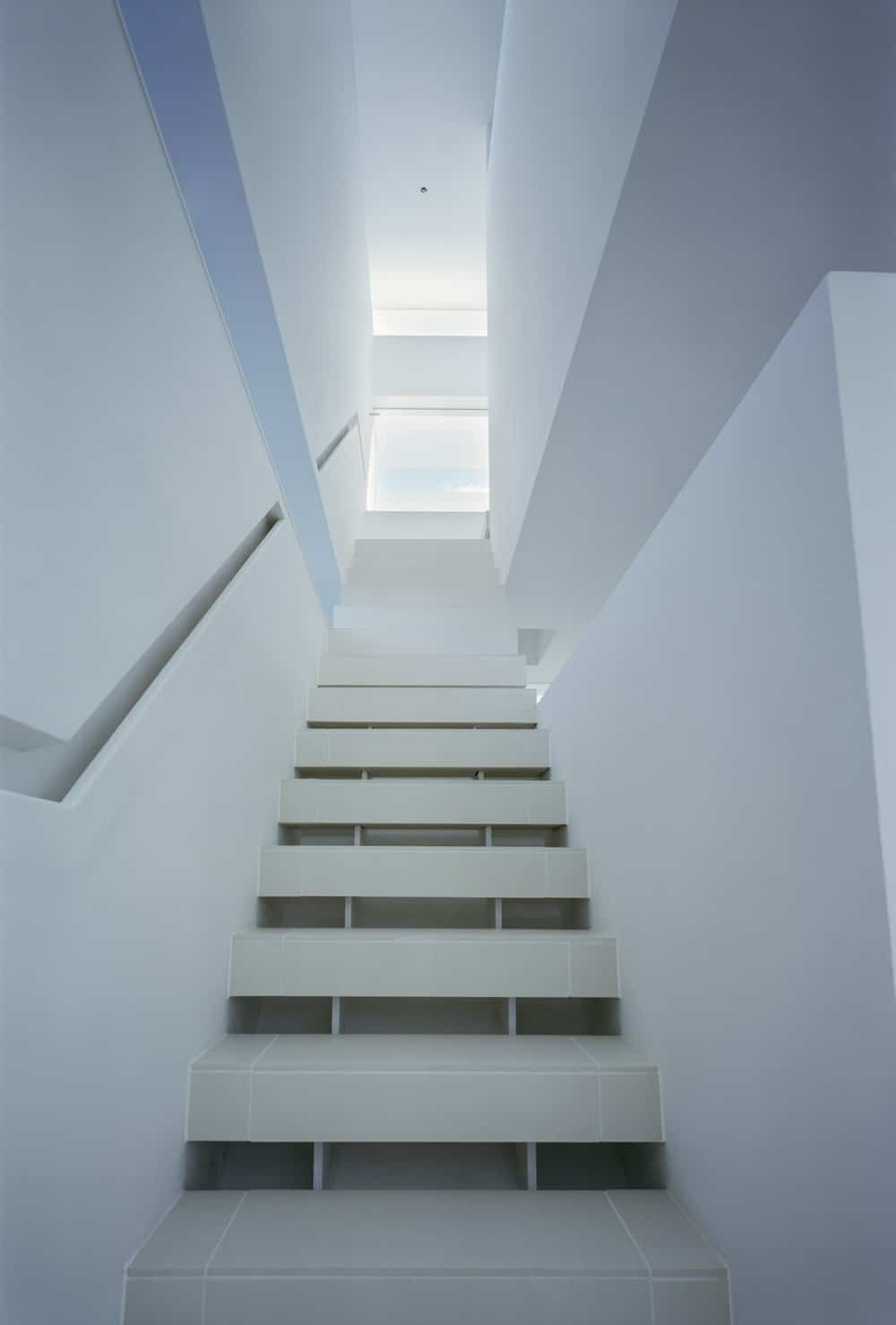 Tiled staircase in the House in Takamatsu designed by Fujiwaramuro Architects.