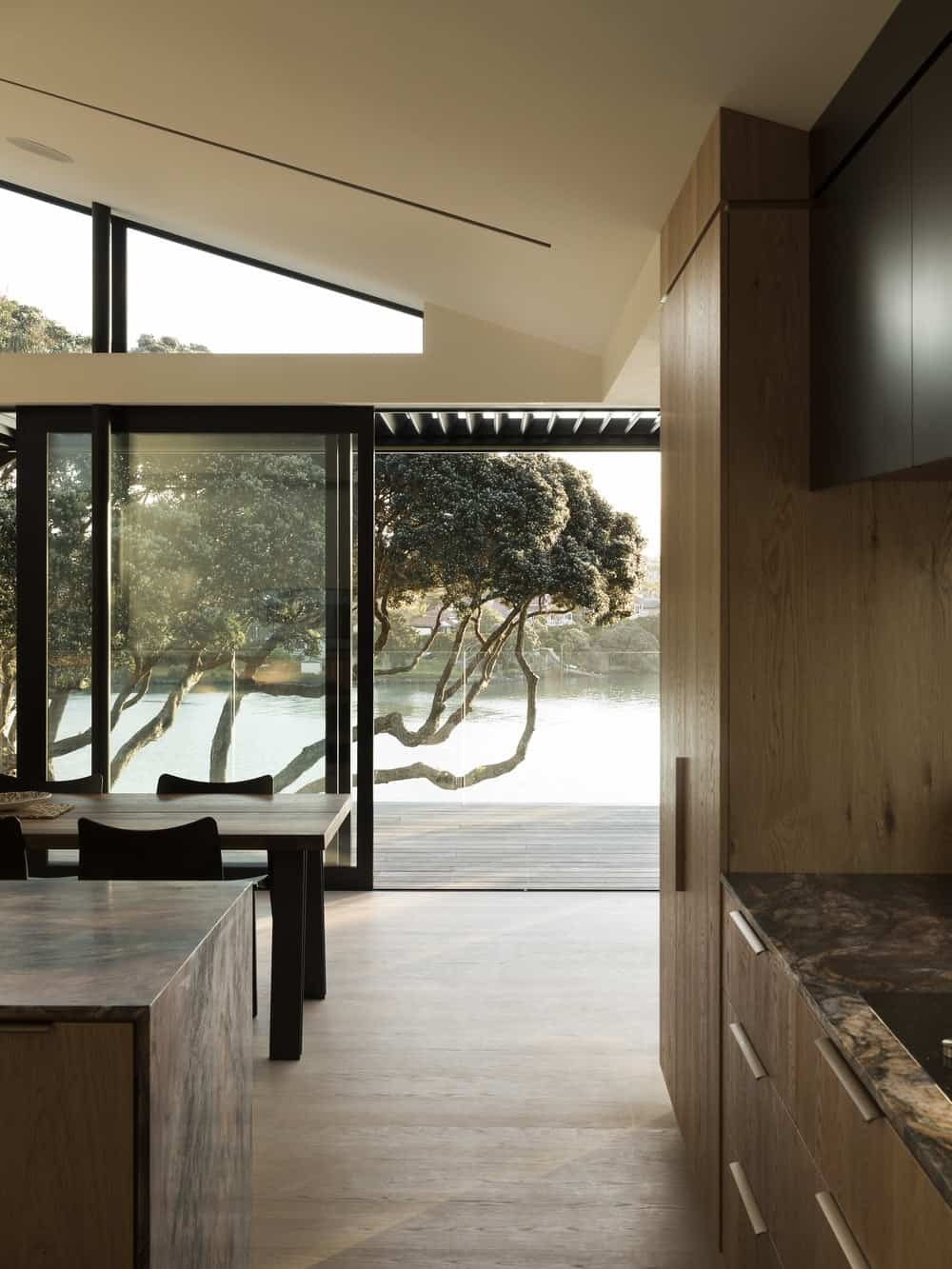Sliding glass door leading out to the patio in the Herne Bay Hideaway designed by Lloyd Hartley Architects.