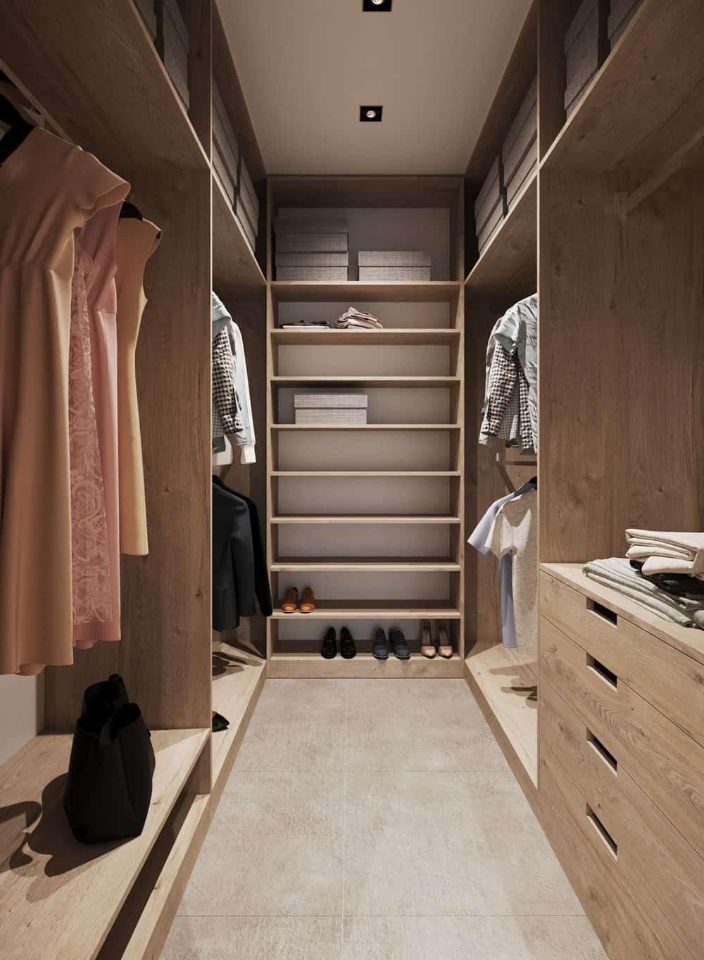 Walk-in closet in the Minimalist Home Interior designed by Johny Mrazko and Studioe.