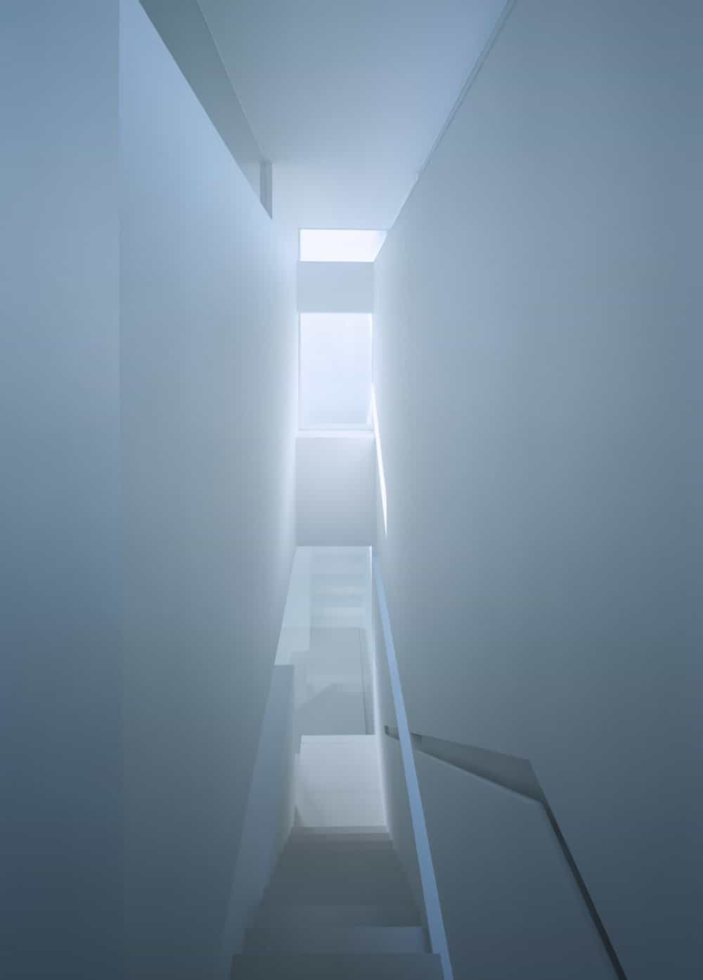 Staircase facing the glazed windows in the House in Takamatsu designed by Fujiwaramuro Architects.
