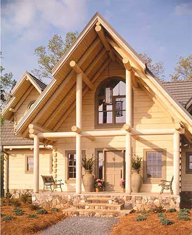 Two-story log home with decorative beams and a covered porch.