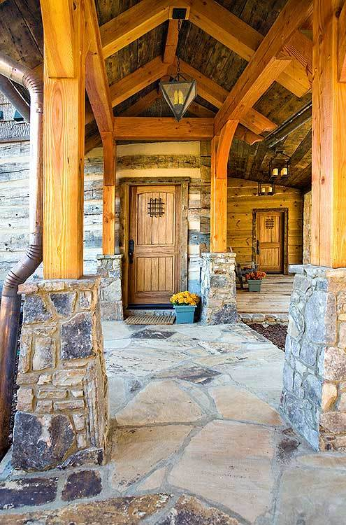 Paved stone covered walkway leading to the front door.