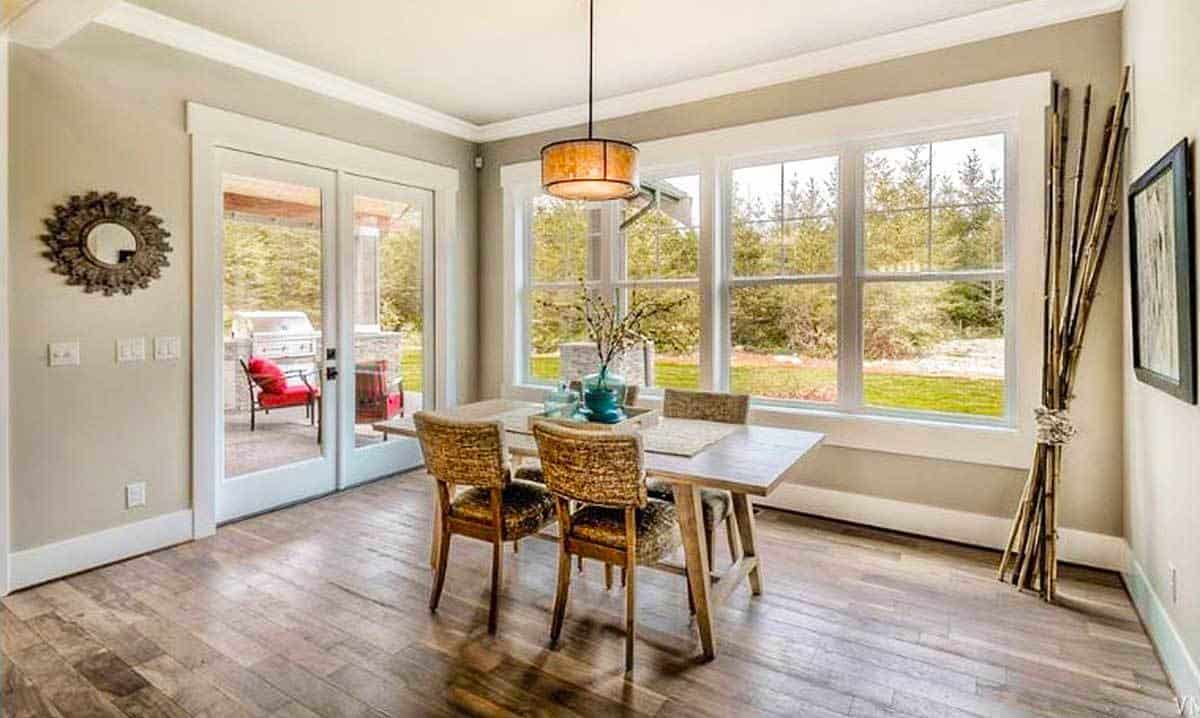 The breakfast nook showcases plenty of white framed windows and a french door that looks out to the patio.