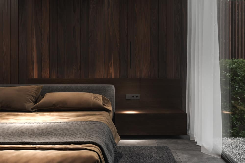 Bedroom in front of the living area in the Forest House designed by Bezmirno.