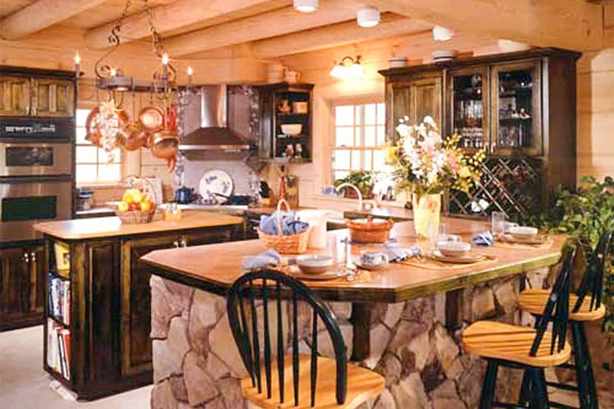 The kitchen has a hanging pot rack chandelier, a central island, and a breakfast peninsula.