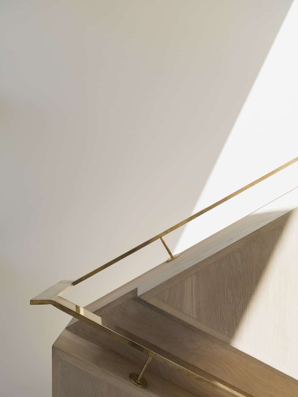 Staircase brass railings in the Herne Bay Hideaway designed by Lloyd Hartley Architects.