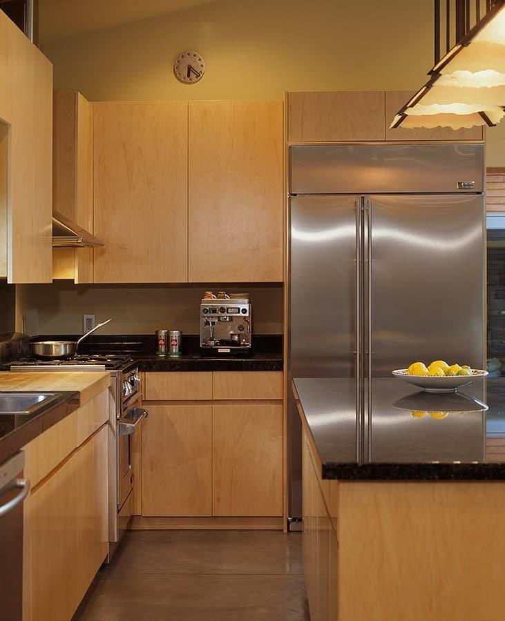 Kitchen in The Manzanita House designed by Klopf Architecture.