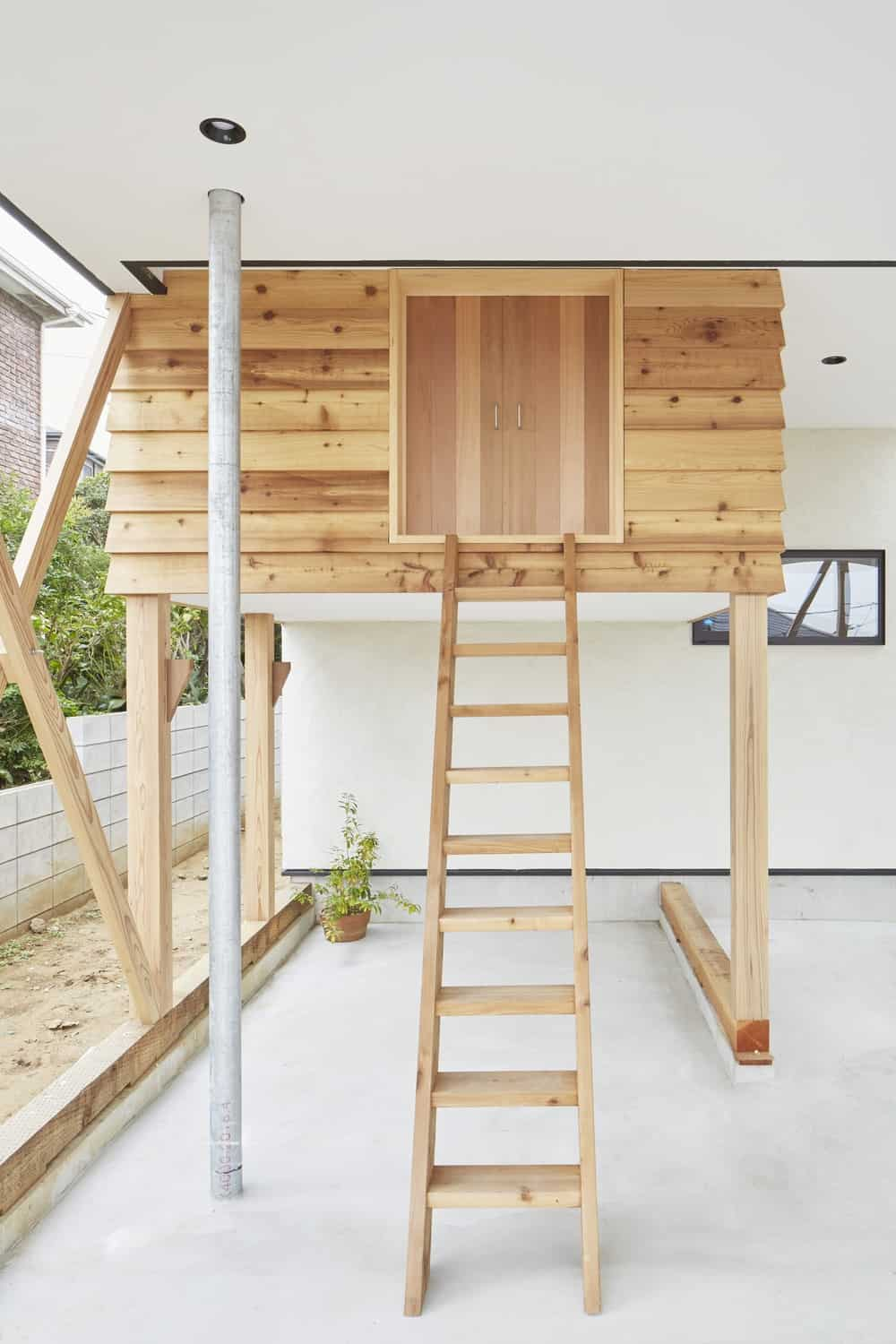 Wooden ladder in the Triple Stilt House designed by Archidance.