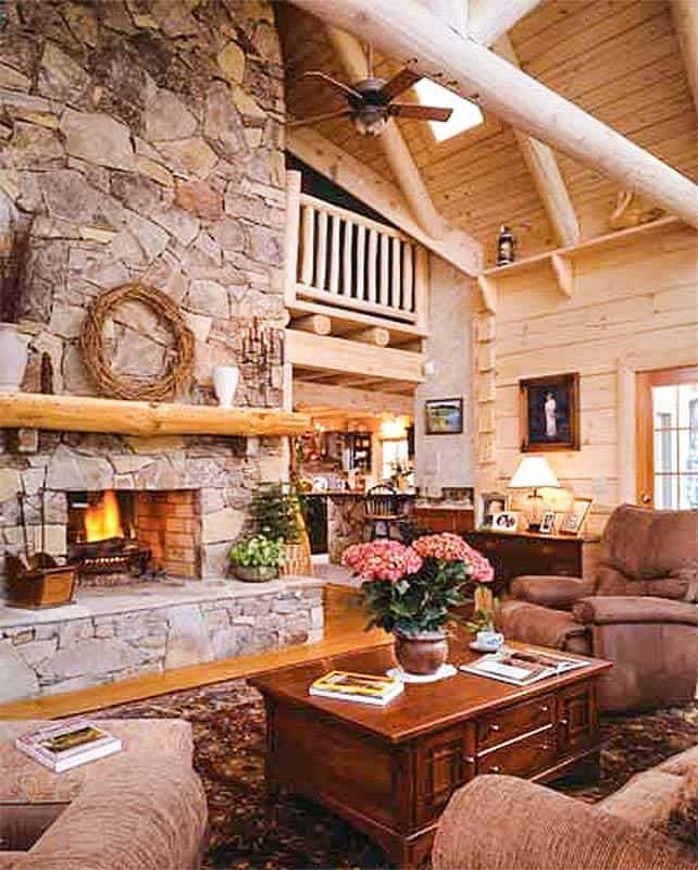 The living room has skylights and a 2-story stone fireplace.