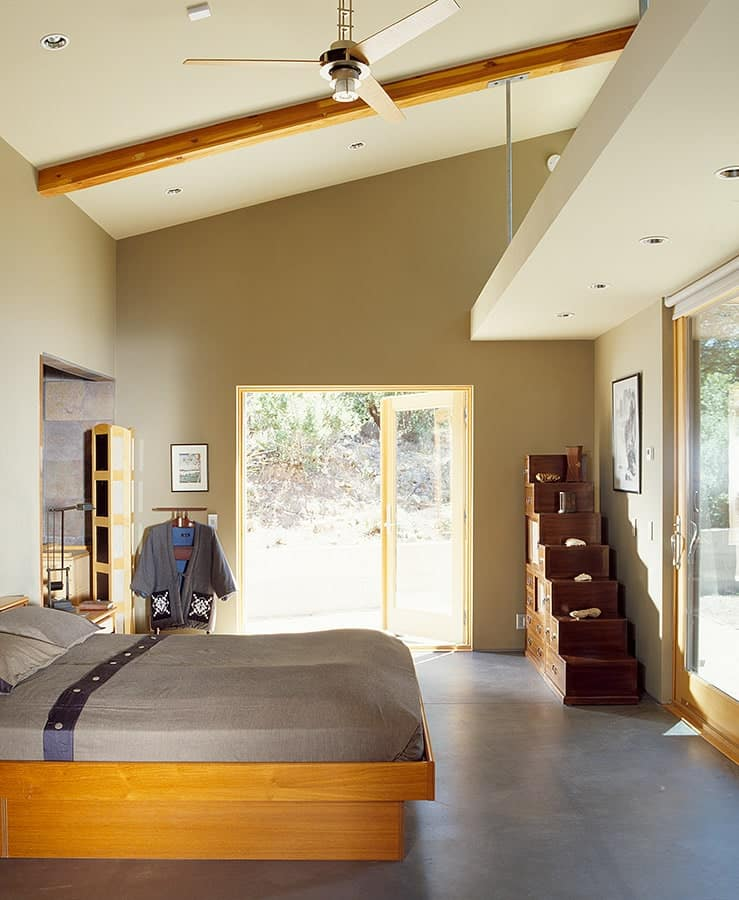 Bedroom in The Manzanita House designed by Klopf Architecture.