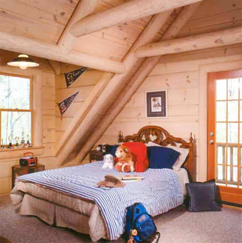 A kid's bedroom with sloped beam ceiling, windows, and access to the upper deck.