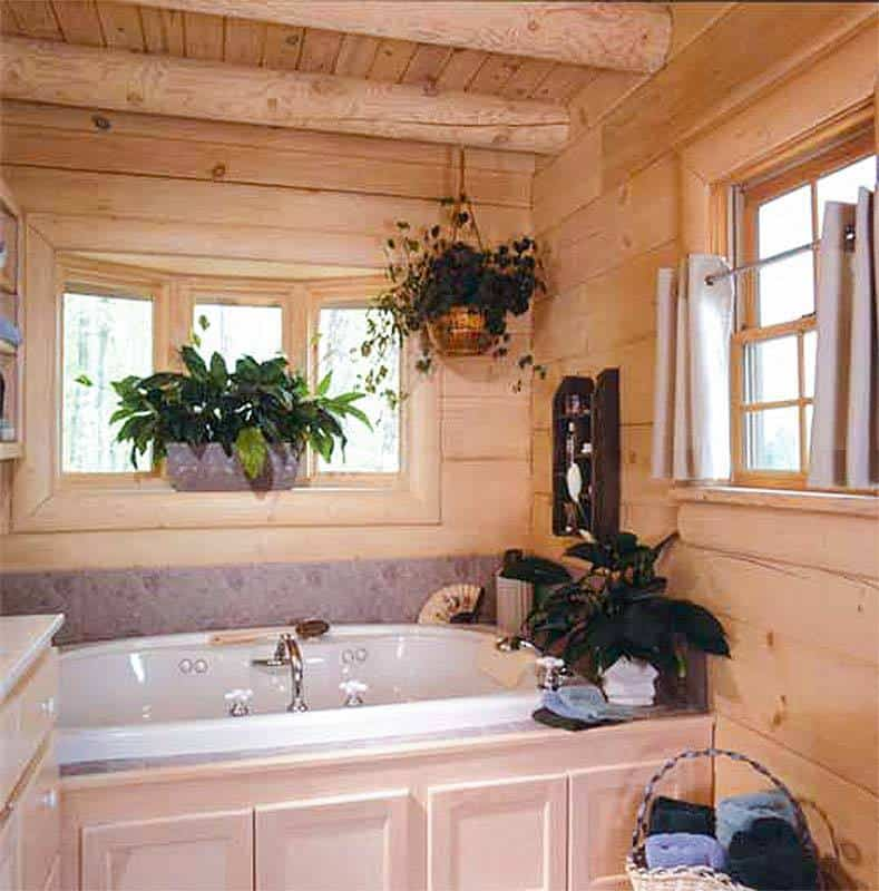 Bathroom with a drop-in tub by the window.