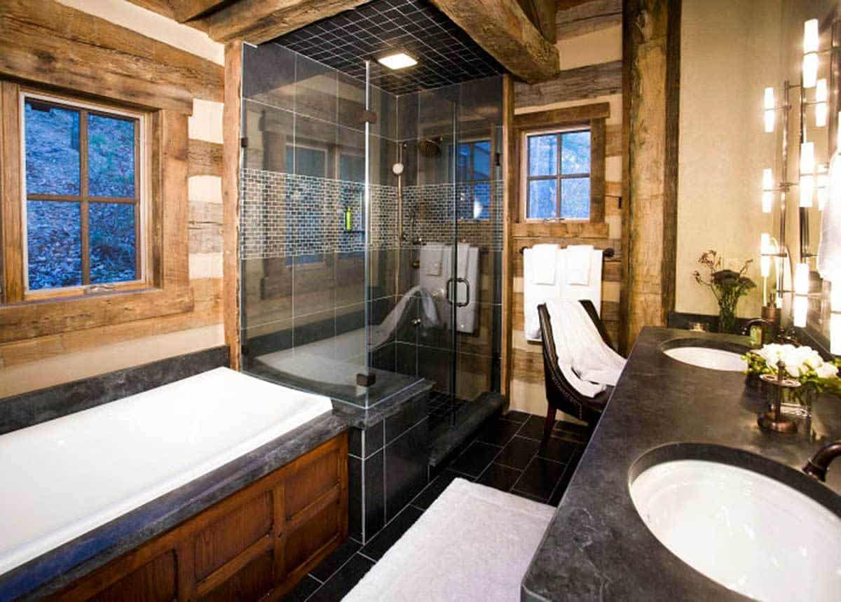 Primary bathroom with a drop-in tub, a shower glass-enclosed shower, and a double sink vanity.