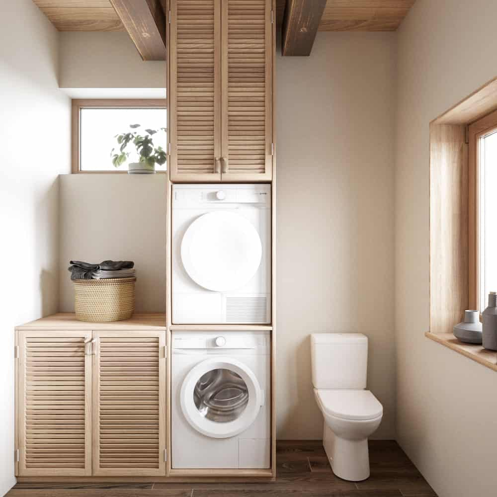 Bathroom and laundry area in the House CZ Downstairs designed by Ruda Studio.