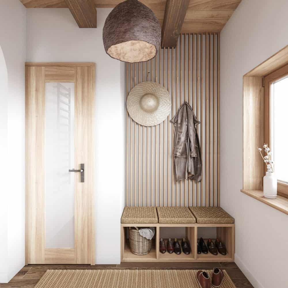 Mudroom in the House CZ Downstairs designed by Ruda Studio.