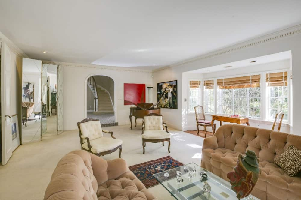 This view of the living room showcases its white walls, white ceiling and white carpeted flooring. Images courtesy of Toptenrealestatedeals.com.