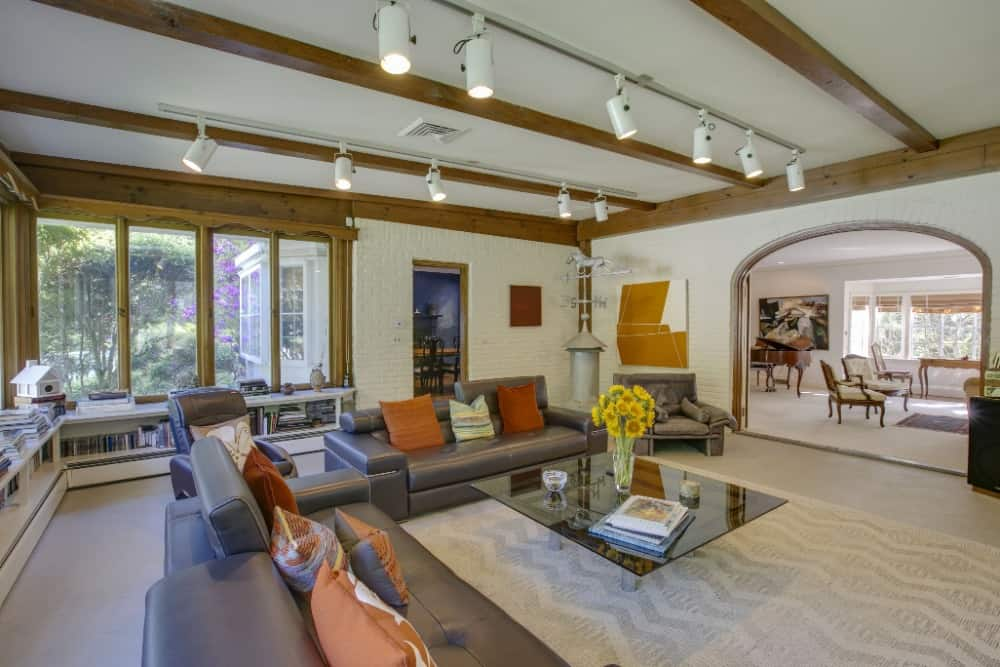 This family room offers a comfy sofa set along with a stylish square glass top center table. Images courtesy of Toptenrealestatedeals.com.