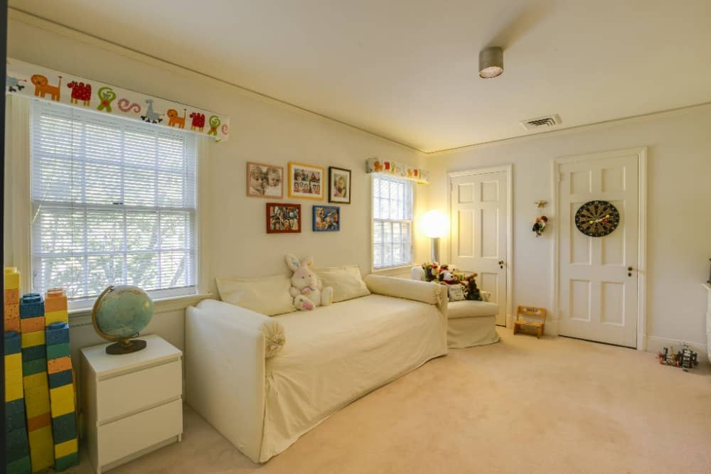 This bedroom suite offers a sitting area on the side boasting its large comfy white couch. Images courtesy of Toptenrealestatedeals.com.