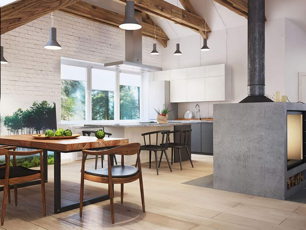 An airy kitchen with a cozy dining area on the side boasting round back chairs and a rich wood dining table supported by a metal base. White framed windows provide natural light in the room.
