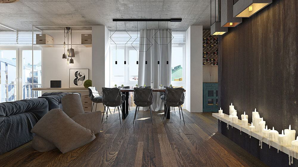 Dark natural wood elements add a heavy contrast to the white walls and distressed ceiling. Sleek geometric pendants can be seen on top of the rectangular dining table surrounded by cushioned chairs.