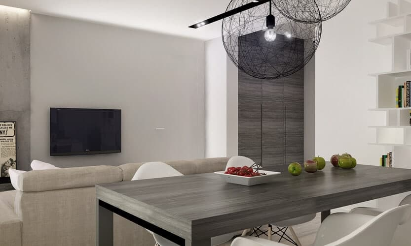 The large, sleek dark wood dining table matches the grey stained hardwood seen elsewhere in the home including the full height wall panels in the distance here. The wireframe sphere chandeliers add a jolt of contrast and style.