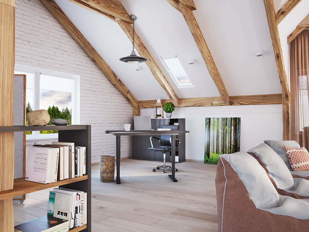 A home office setting in the corner side of the living area. It is defined by a black writing desk and chair. The rich natural wood exposed beams can be seen clearly overhead.