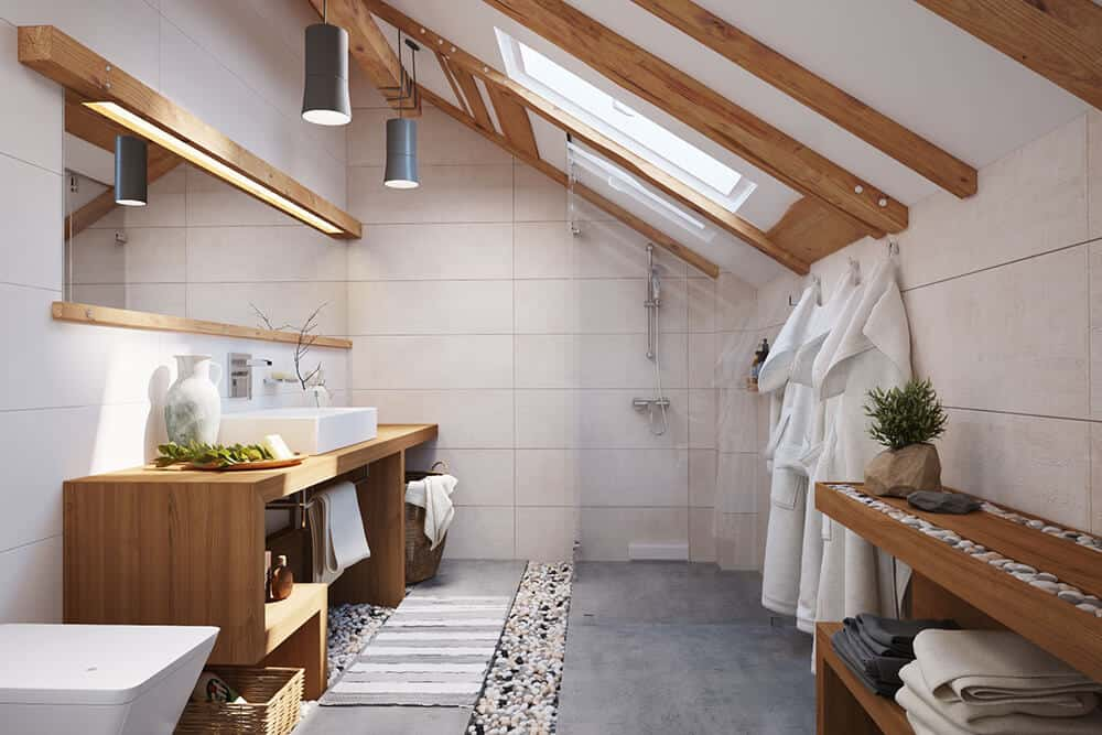 Spacious master bathroom with concrete flooring and a shed ceiling fitted with skylights. Wooden vanity and exposed beams create a cozy vibe in the room.