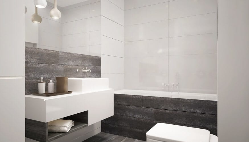 The ultra-sleek bathroom boasts a gray and white color scheme with aged wood panels wrapping the vanity and soaking tub.