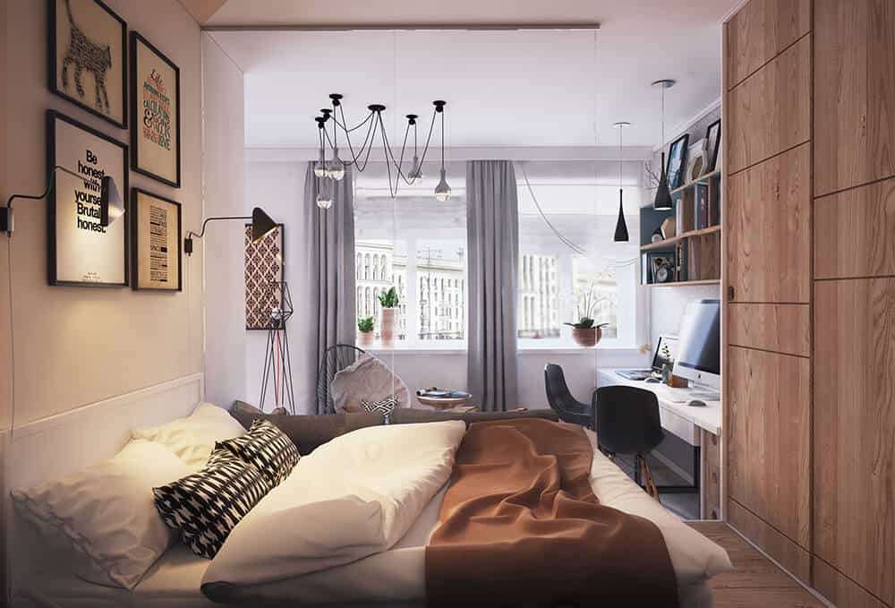 Cozy primary bedroom designed with spider pendant lights and gallery frames fixed above the bed. The room has a wooden desk and wood stained wardrobes that blend in with the hardwood flooring.