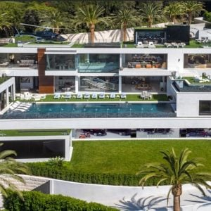 This aerial shot of the giga mansion shows the different levels that has wide glass walls to better enjoy the scenic views. The lowest level has a large garage full of cars, There's a large pool at the backyard and even a helicopter at the rooftop's helipad. Images courtesy of Toptenrealestatedeals.com.