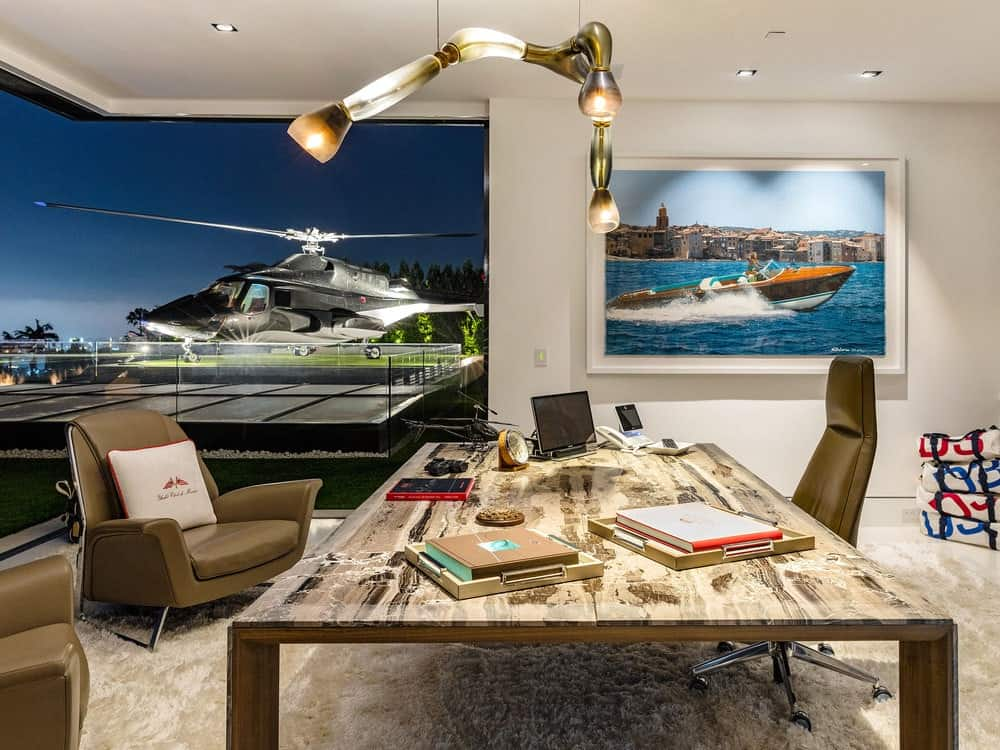 The gorgeous home office has a large wooden desk and matching leather office chair. The highlight of this home office is the amazing view of the helipad where your personal helicopter is parked. Images courtesy of Toptenrealestatedeals.com.
