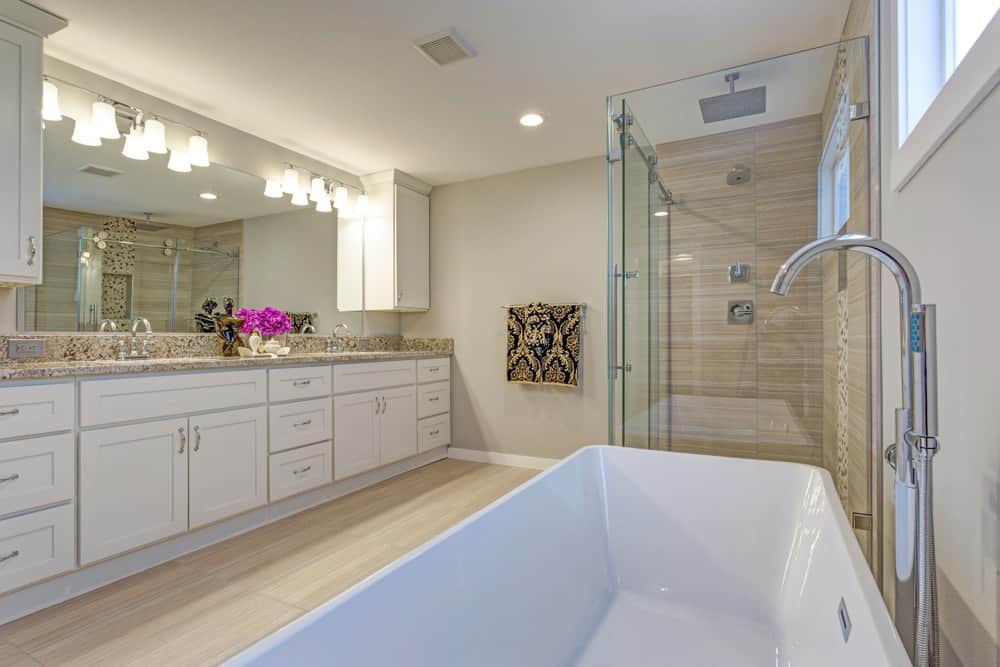A charming primary bathroom with beige walls and ceiling.