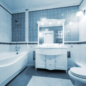 A beautiful master bathroom with blue tiles on the walls and flooring.