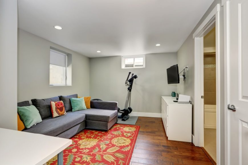 A simple yet lovely basement with gray walls and ceiling.