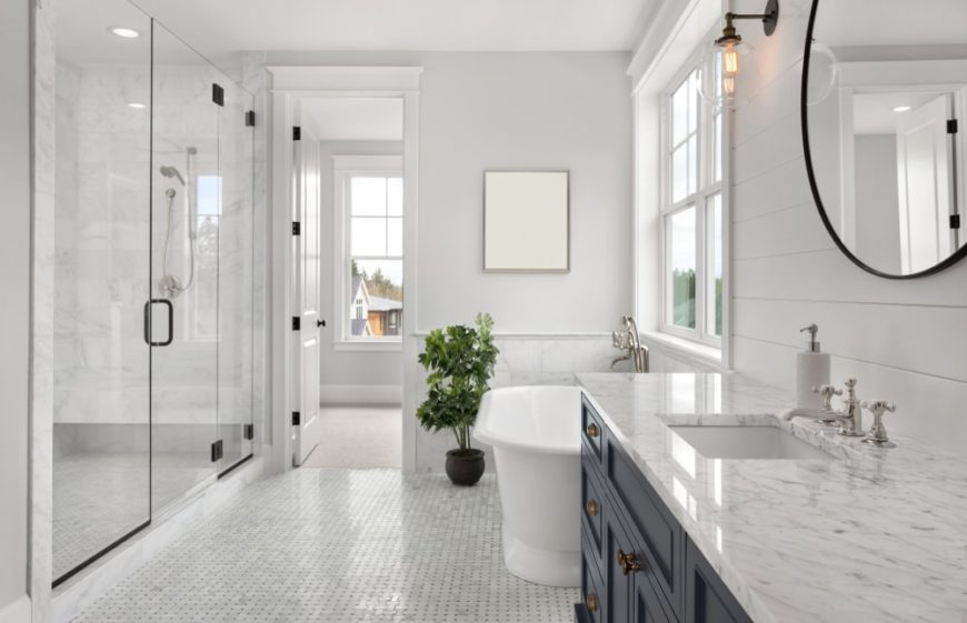 A bright primary bathroom with white walls, ceiling and flooring.