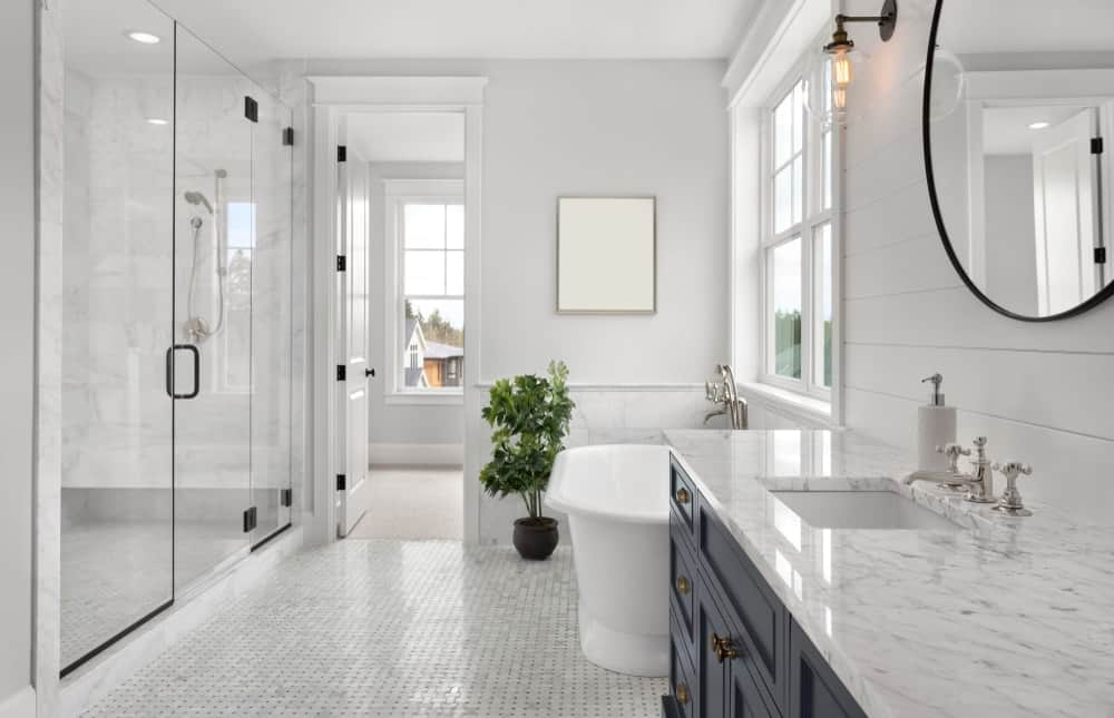 A bright master bathroom with white walls, ceiling and flooring.
