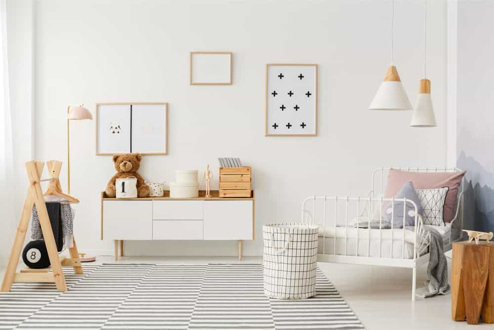 A lovely kid's bedroom with bright white walls.