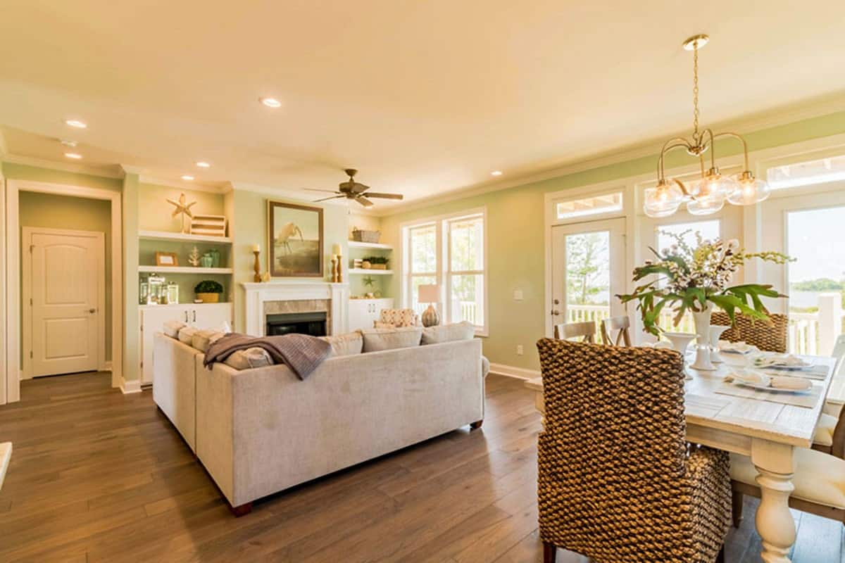 Ambient lighting from the glass chandelier and recessed ceiling lights fill the room for a warm and cozy feel.