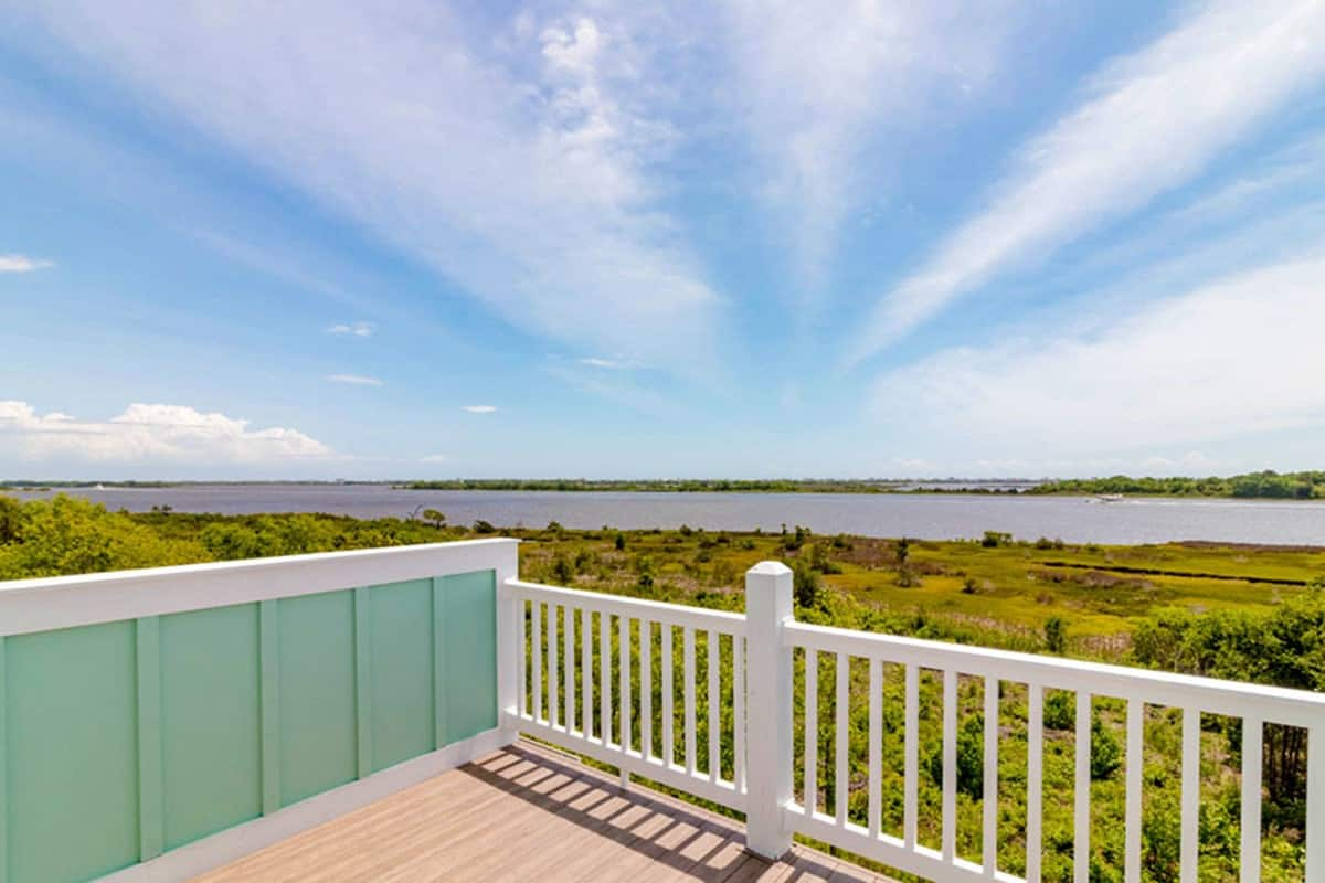 A breathtaking view of the expansive greenery and stunning sea enjoyed from the balcony.