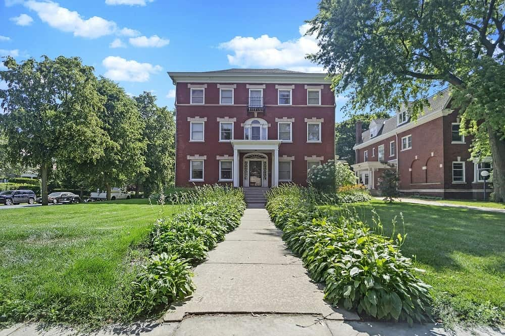 A beautiful mansion with brick walls complemented by the white trim of the windows. Images courtesy of Toptenrealestatedeals.com.