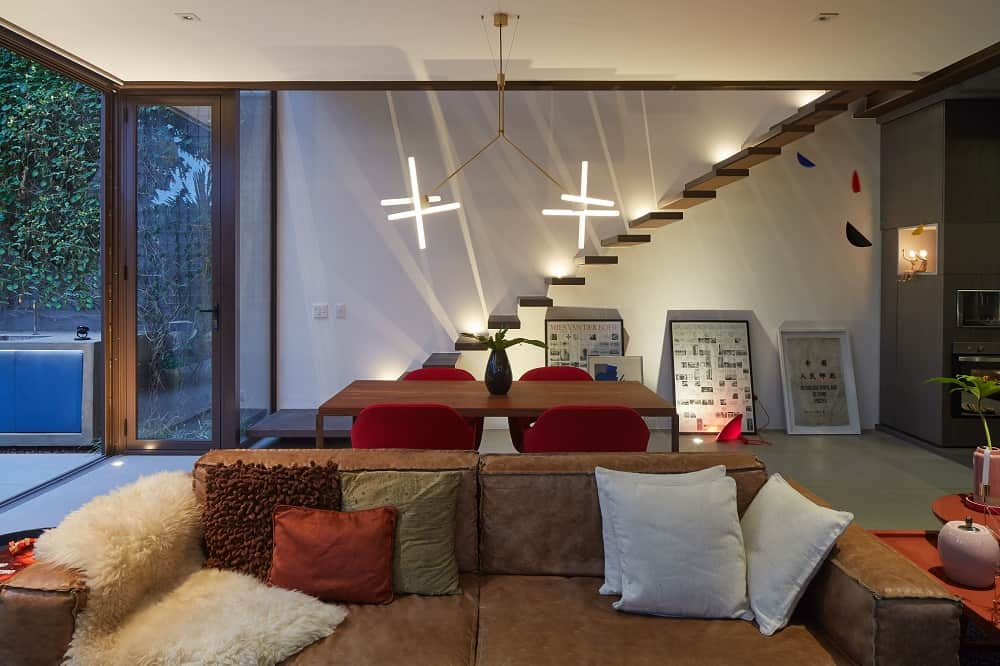 Living area and dining space in the Casa Box designed by Flavio Castro.