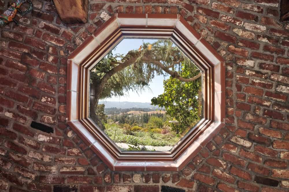 There is a beautiful octagonal window made of bricks that can function as a gorgeous reading nook. Images courtesy of Toptenrealestatedeals.com.