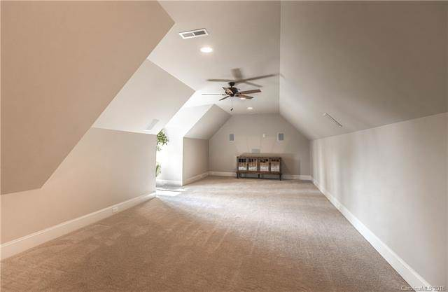 This large open area has a cove ceiling that has recessed lights and a ceiling fan in the middle. There is enough space in this big bonus room for a small gathering or party. Source: TheHouseDesigners.com