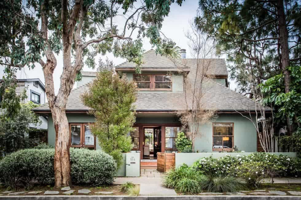 The front view from the street of this classic Craftsman-style home gives it a warm homey feel. It is foregrounded by a beautiful mature landscaping that has tall trees and lush shrubbery that give complement to the home exterior walls. Images courtesy of Toptenrealestatedeals.com.