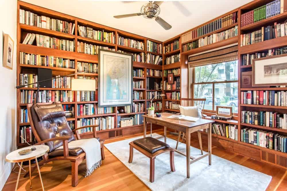 Just a few steps from the dining area is the library that also functions as an office with its simple wooden desk and chair in the middle. Images courtesy of Toptenrealestatedeals.com.