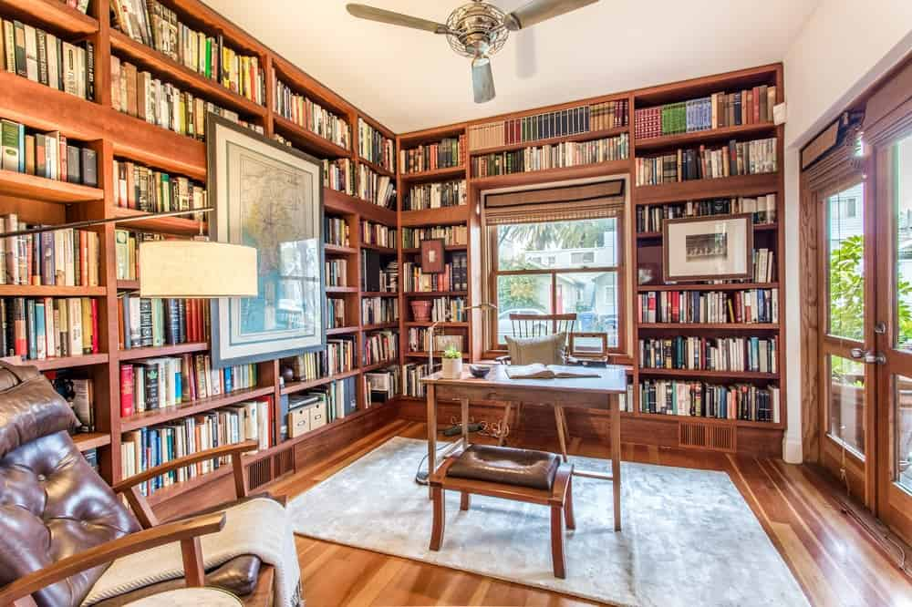 The walls of this library are dominated by tall built-in wooden bookshelves that match the tone of the hardwood flooring. Images courtesy of Toptenrealestatedeals.com.